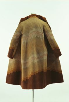 Sonia Delaunay, coat, 1920s.  Brown wool embroidered with yarn and silk threadDelaunay, who started her career as painter in 1910, began to design a wide range of articles including textiles and dresses around 1925, crossing the border between fine arts and fashion. Rather than designing high fashion, she created dresses as one of her medium of artistic expression. Kyoto Costume Institute