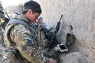 Undated image released by the British Army Monday Feb 4 2013 of Sergeant Scott Weaver, of The Queens Royal Lancers launching a newly issued Black Hornet miniature surveillance helicopter during an operation in Afghanistan. The Scandinavian-designed Black Hornet Nano weighs as little as 16 grams (0.56 ounces) — the same as a finch. The four-inch-long (10-centimeter-long) helicopter is fitted with a tiny camera which relays still images and video to a remote terminal. Troops used the drone to…