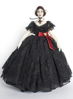 Frimousses de Createurs 2014: see Dolce&Gabbana Violetta doll for Unicef:  the doll is called Violetta and is inspired by the main character in Verdi's La Traviata. She wears a typically 19th century evening dress fashioned with black lace dress a red satin belt, adorned by a crystal brooch. She also wears a gold cross with black stones, a classic Dolce & Gabbana jewel. Violetta is made from resin with her her face painted by hand.