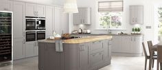 """i like the use of colour and material on the island, but a bit too """"country kitchen"""" for here."""