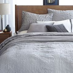 Could work well with his current sheets / pillow covers. Crinkle Duvet Cover + Shams - Feather Gray
