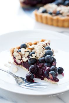 [three words i love to hear together. isn't this so pretty?] Blueberry Almond Tart via @Lindsay Landis (Love & Olive Oil)