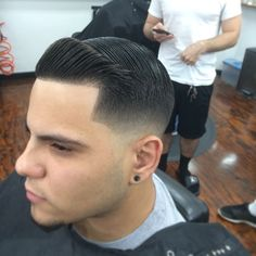 Tight low fade with combover and crisp line-up