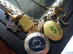 Hunger Games Necklace Peeta's locket with by TheMeltonPot <-- THAT IS HARRY POTTER NOT HUNGER GAMES