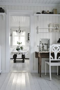 White upon white upon white.  So crisp and fresh.  (I think I would have added a little wicker here and there, just for a touch of rustic.)