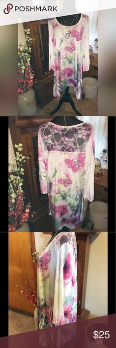 Beautiful Tunic NWOT. This lightweight beauty is perfect with leggings of any length.  I bought this at a Cracker Barrel Store and never wore it.  It features a tablecloth hemline and a pretty lace back yoke.  You will love it!! Cal Style Tops Tunics