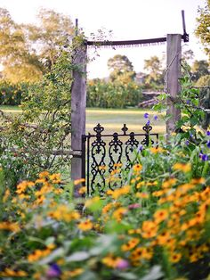 Investing in a truly gorgeous gate will pay off in the long run! More rustic garden inspiration: http://www.bhg.com/gardening/design/styles/rustic-garden/?socsrc=bhgpin070514gorgeousgate&page=1