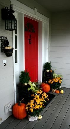 Fall Porch Ideas - Today's Creative Blog for @Lowe's. Love the red door with the pop of white around it with the grey siding.
