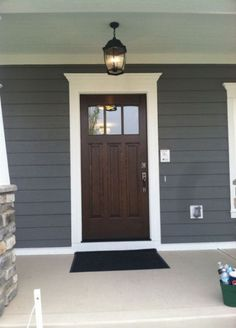 Front Door Colors For Grey House Dark Wood With White Trim And Blue Grey Siding Front Door With Windows, Blue Color Of House With White Trim House Paint Exterior, Exterior House Colors, Exterior Doors, Exterior Trim, Bungalow Exterior, Exterior Remodel, Exterior Paint Colors, Paint Colours, Exterior Design