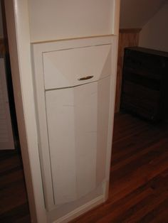 Between-the-studs built-in hamper. Wonder if this would work for trash cans?