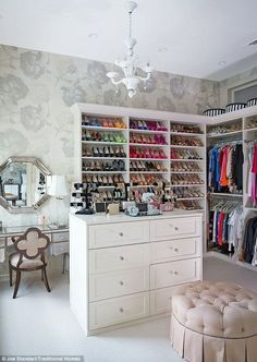 Dream closet! Lots of shoes, vanity, and dresser!