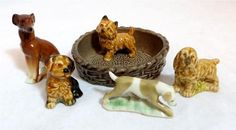 Whole bunch of Wade Whimsies coming up... Vintage Wade Whimsies 4 Dogs, Spaniel, Black & Tan Pup + Terrier Basket Ashtray - starting at £0.99 on ebay
