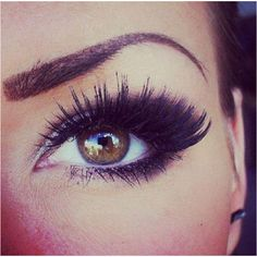 Black eyeshadow on outer end of eyes for a more dramatic effect along with thick falsies