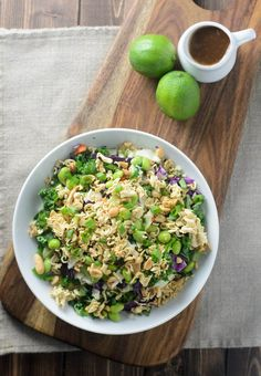 Salad with cabbage, kale, edamame, cauliflower and topped with lime ...