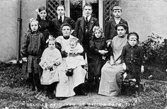 https://flic.kr/p/9yuFW8   Belgian refugees at Witton Park.   Belgian refugees at Witton Park. Families Peeters and Cypers. Back row: Anna Peeters, Louis Peeters, Joannes Peeters, ? Cypers; Middle row: M Justine Peeters, M T Verelst, ? Cypers, ? Cypers; front row: Mathilde Peeters, Edward Peeters (on knee), ? Cypers.