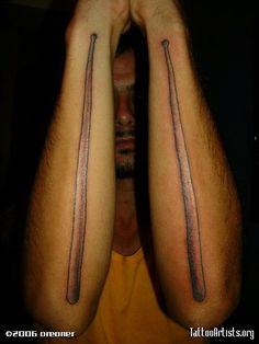Sexy drum sticks clef note tattoo