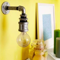 Pipe Sconce..Create an industrial look with custom sconces made from piping. Run a socket kit through the pipe and pipe fittings, and hard-wire it into the wall.