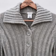 🌊Gap button down sweater🌻 Get into this cozy Gap sweater❄️long sleeves two front pockets 6 big buttons on the front and high collar perfect for the upcoming season! Gray in color! 10% wool, 90% acrylic. Flaw noted in 3rd photo~ 1 teeny tiny pull on the pocket but other than that in Really good condition! Make me an offer✌🏼️😊no trades thank you GAP Sweaters Cardigans
