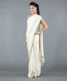 Channel your inner goddess with this ivory-colored crepe saree! Buy: $298 #Luxemi