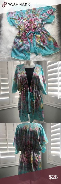 Cabi Silk Kimono - Size Medium Gorgeous gathered front tie kimono by Cabi. The aqua floral pattern is beautiful. It's silk and lightweight. Size medium. There is one small blemish (ink pen mark) on left tie as shown in pic but seriously not noticeable. CAbi Tops