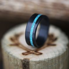 Fire-treated black zirconium wedding ring with hand-crushed turquoise inlay. Handcrafted by Staghead Designs.