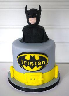 NOT the creepy Batman, but the name inside the bat symbol.