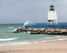 Lake Charlevoix, Michigan: Light on the Pier at Lake Charlevoix I want to go sailing because I love the water! It also is one of my favorite places to go and that is why I want to sail here.