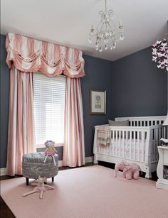 Striped Pink and White Curtains elongate the room. Lovely with dark gray walls in this baby girl nursery!