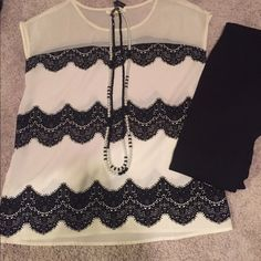 Black and cream elegant top Adorable and elegant black and cream top. Never been worn but have taken the tags off. Bought from a boutique. Has black lace like details along top. Can be dressed up or down. Excellent condition! Tops Blouses