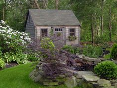 A lush grass pathway leads around a rock-lined pond and   toward the quaint shed. Posted by Rate My Space contributor tumbestere.