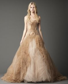 Strapless full A-line gown with pleated tulle swirled ruffle and asymmetrical sheared flange