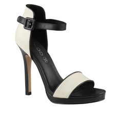 Why I like these? - 4.5 inch heel - Black and white color contrast - 2 strap minimalist design with backing