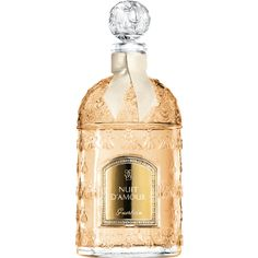 """Jean-Paul Guerlain created Nuit d'Amour as a tribute to Gustav Klimt and one of his works of art: """"Lady with Hat and Feather Boa."""" This floral, powdery and woody fragrance recalls the stirring emotion that might strike when you encounter an unknown woman with indefinable charm. The fragrance is showcased in the iconic Bee bottle, which exceptionally takes on an oh-so-chic 125 ml format.  2006 re-edition."""