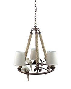 """You can spruce up your home with this <a href=""""http://www.parrotuncle.com/pendant-lighting.html"""">ingeniously designed pendant light</a>. Three hemp ropes hang a round metal base, which is in distressed rust finish. Protruding from the circle are metal branches with hammered-out metal leaves. The base supports three off-white shades fashioned from fabric. Most noticeable are bird shape ornaments that boast different poses, which bring life to the pendant."""