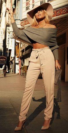 stylish. wrap crop knit. high waisted trousers. hat. heels.