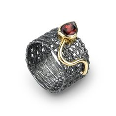 Ring | German Kabirski.  Sterling silver, garnet, rhodium and gold plated