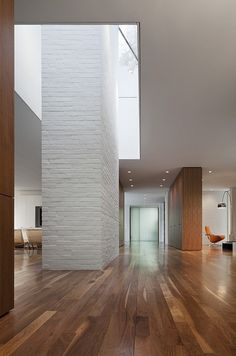 Record House revisited by David Jameson Architect. Great classical modern interior. Beautiful how the light brings the texture of the chimney to life.