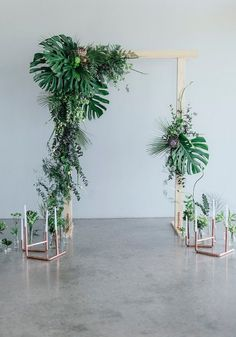 Greenery and Copper wedding ceremony arch recipe: grouping flowers, greenery and foliage together in sections, instead of creating arrangements with symmetry which is common practice. Used: artichokes, eucalyptus, philodendron, ivy, monsteras, ferns, chrysanthemums, and fan palms. Click for more ideas. http://www.confettidaydreams.com/greenery-and-copper-wedding-ideas/ Images: Debbie Lourens // Styling Erin HAPPINEST