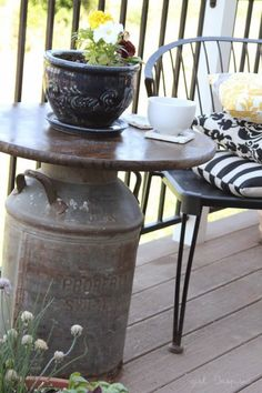 A coffee table , made from an antique milking pail