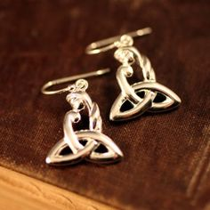 """Our Celtic Mother's Knot Earrings are a brilliant gift for any mom or mother to be. """"Grá Máthair"""" translated from Gaelic means """"A mother's love"""". Is there any love greater then that of a mother and her children? There is an old Irish saying that says """"A mother holds her children's hands for a little while and their hearts forever."""""""