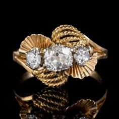 An unusual French ring from the early Century made up of two elaborate fan-like panels and tangles of rope with three stunning old Mine cut Diamonds set out across the centre. Antique Diamond Rings, Antique Engagement Rings, Gold Ring Photo, Twist Ring, Perfect Engagement Ring, Gold Style, Gemstone Colors, Vintage Rings, French Vintage