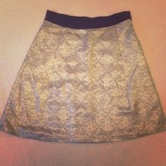 Narciso Rodriguez skirt size 4 Narciso Rodriguez skirt . Beautiful gold metalic skirts,rayon ,polyester, and spandex blend. Knee length. The pictures do not do this justice... This is beatiful and in excellent condition. Narciso Rodriguez Skirts Midi