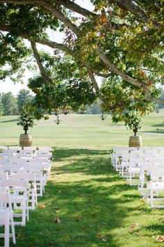 Such a stunning ceremony setting. Photography: Angela Newton Roy Photography - www.angelanewtonroy.com  Read More: http://www.stylemepretty.com/2014/06/04/traditional-meets-rustic-country-club-wedding/