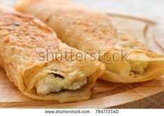 Pancakes stuffed with cottage cheese and raisins. Stock photography, images, pictures, Illustrations, ideas. Download vector illustrations and photos on Shutterstock, Istockphoto, Fotolia, Adobe, Dreamstime