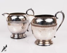 Pair of Sheridan Silverplated Round/Ball Shape Water Pitchers with Beautiful Rope Detailing - Downton Abbey Style! by TheCordialMagpie from Etsy. Find it now at http://ift.tt/29glC6h!