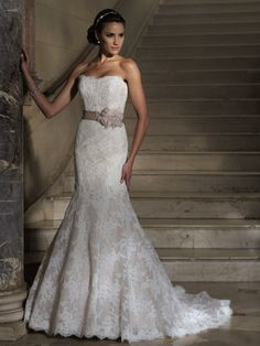 David Tutera - Strapless lace applique bodice features self-tied grosgrain ribbon belt adorned with three-dimensional jewel beaded organza flower, scalloped hemline spills into sweep train, detachable