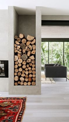 fireplace wood storage. http://frenchyfancy.com/idees-inspirations-photos-de-decoration-interieur-148/