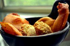 Pakora Basket  Assorted pakoras and chukkas made with saboodana, aubergine, potato fried to a golden crisp, served with chutneys