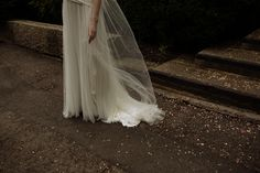 Bride with long veil in Boho style dress.