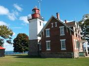 Upstate New York boasts some gorgeous and historic lighthouses. One even has features a bust on it sculpted by famous French artist Rodin.